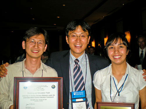 Associate professor Young-Jun Son (center), and PhD students Seungho Lee (left) and Nurcin Celik celebrate their awards at a reception at the IIE Conference and Expo in Miami.