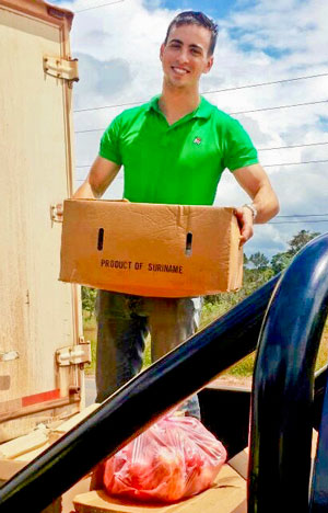 Andrew DeSantola donated food to residents of Suriname while working at the Rosebel mine. (Photo courtesy of Andrew DeSantola)