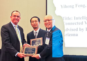 Yiheng Feng, center, with his best dissertation award from the Chinese Overseas Transportation Organization with UA professor Larry Head, left, and COTA president Yafeng Yin.