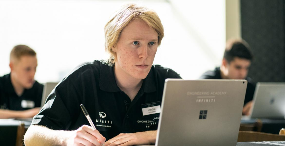 Andre Schreiber looking intently at a laptop screen.