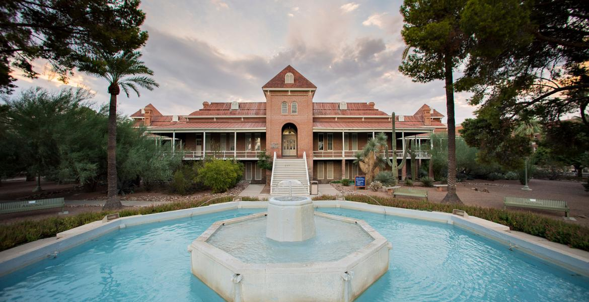 A shot of the University of Arizona's Old Main building, with a fountain in the foreground.