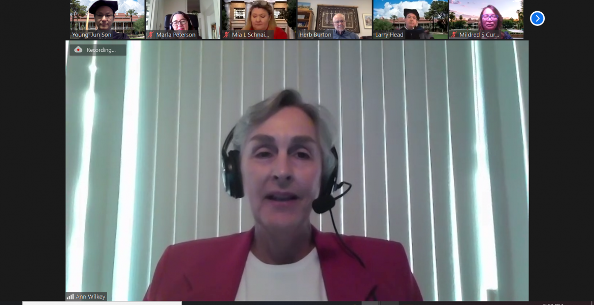Screenshot of a Zoom meeting, with Ann Wilkey full screen and a few other people lined up across the top.