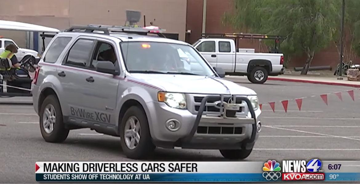 Screencap of a newscast with a car driving across the frame and a lower-third caption that reads,