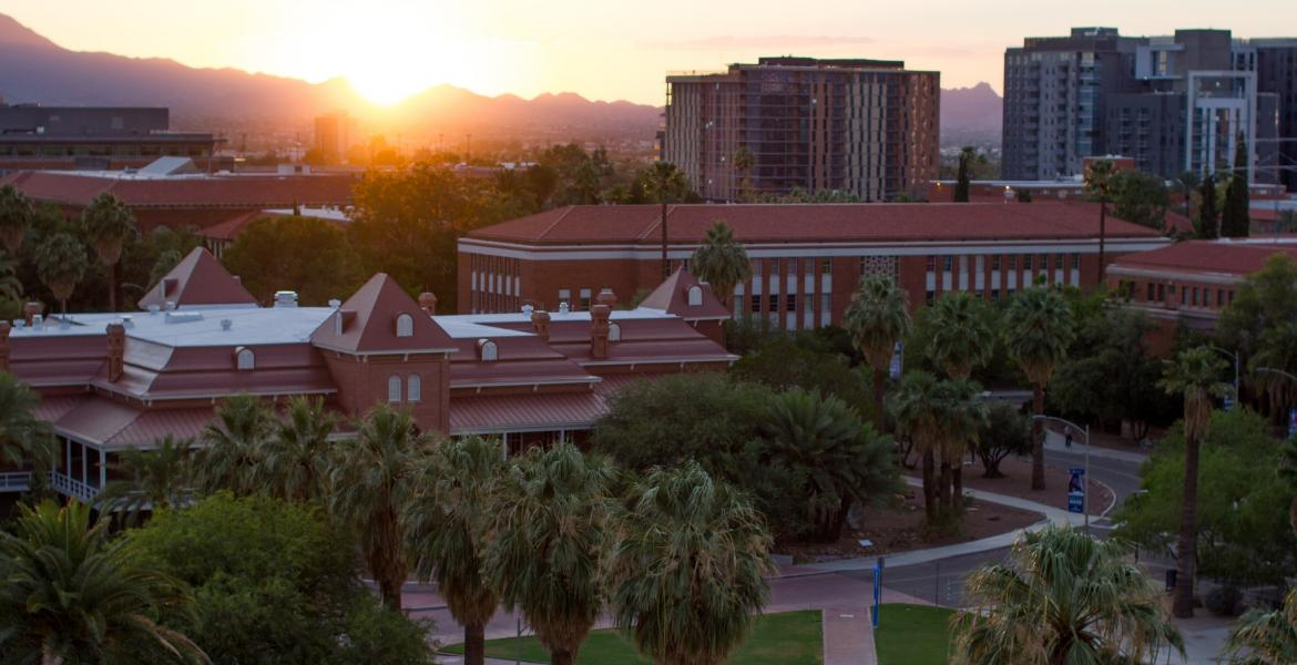 The University of Arizona mall and Old Main building, seen from above at sunset.