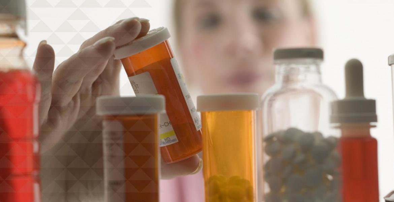 a pharmacist examines medications