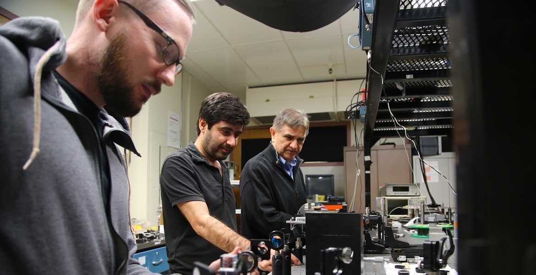 Joshua Olson, Veysi Demir and Nasser Peyghambarian in the lab