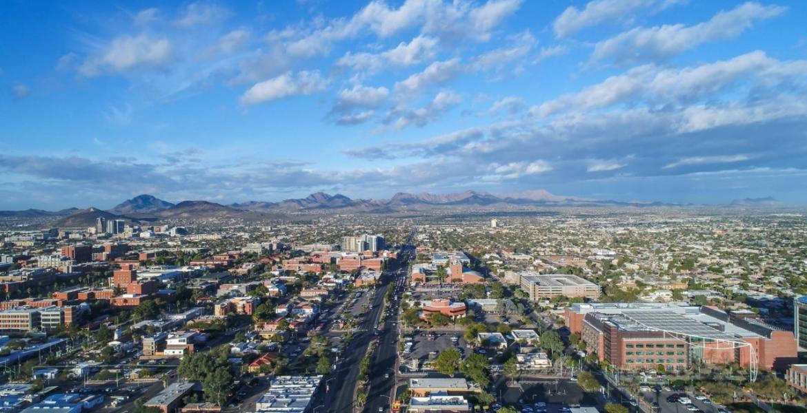 An aerial view of Tucson, looking from the east, including Speedway Boulevard and parts of the University of Arizona campus.