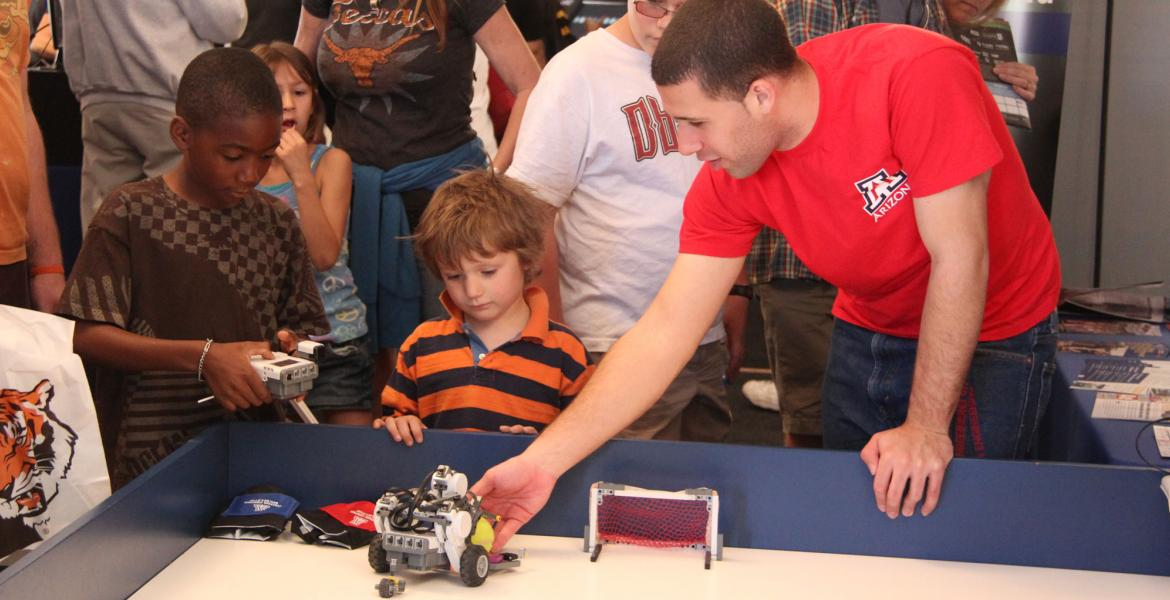 kids playing with robots