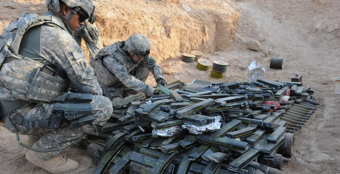 soldiers with weapons cache