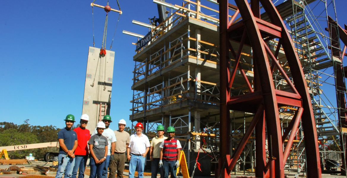engineers standing next to giant earthquake test rig