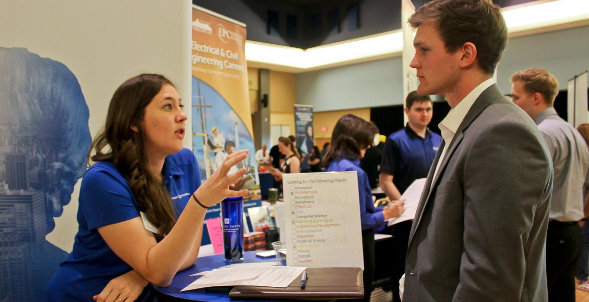 engineer and student at recruitment fair