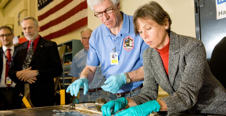 scientists examining sample material
