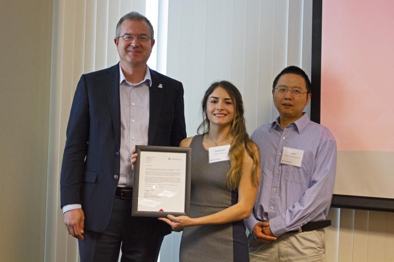 Elizabeth Pelto, outstanding senior in industrial engineering, with nominator Sean Wu and Craig M. Berge Dean David Hahn.