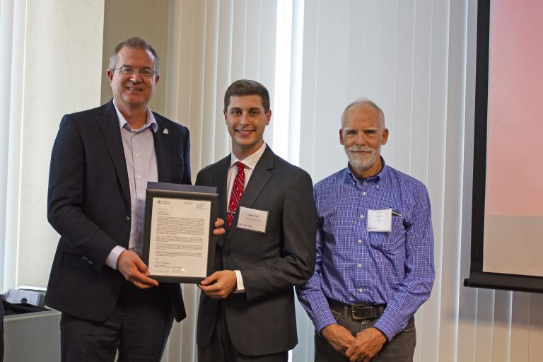 Josh Pace, outstanding senior in biomedical engineering, with nominator Art Gmitro and Craig M. Berge Dean David Hahn.