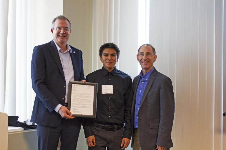 Daylan Toledo, outstanding senior in civil engineering, with nominator Dean Papajohn and Craig M. Berge Dean David Hahn.