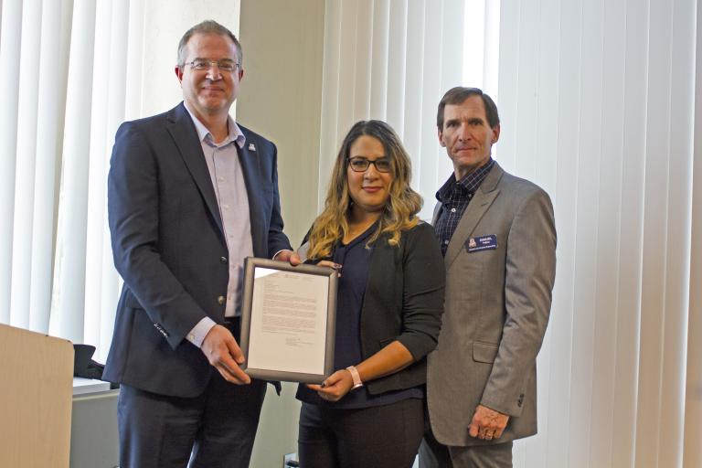 Yesenia Machuca, outstanding senior in systems engineering, with nominator Sam Peffers and Craig M. Berge Dean David Hahn.