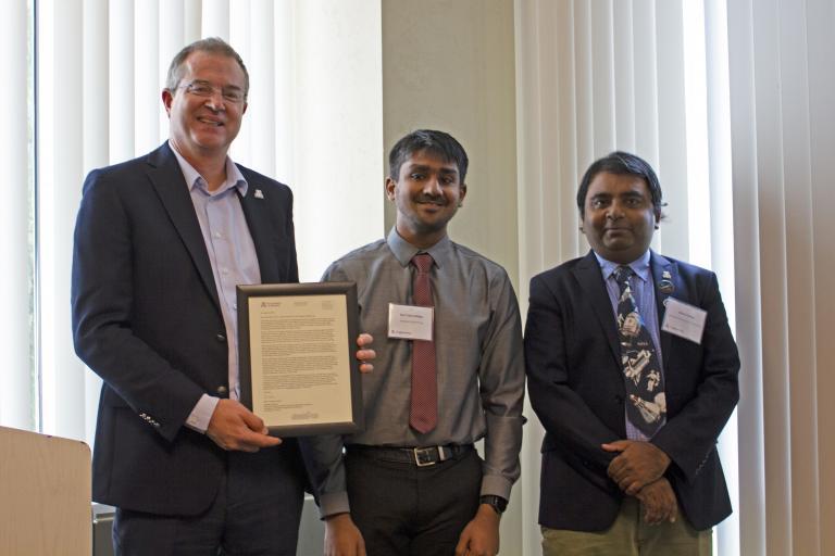Ravi Teja Nallapu, outstanding graduate student in aerospace engineering, with nominator Jekan Thanga and Craig M. Berge Dean David Hahn.