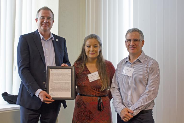 Marissa Lopez-Pier, outstanding graduate student in biomedical engineering, with nominator John Konhilas and Craig M. Berge Dean David Hahn.