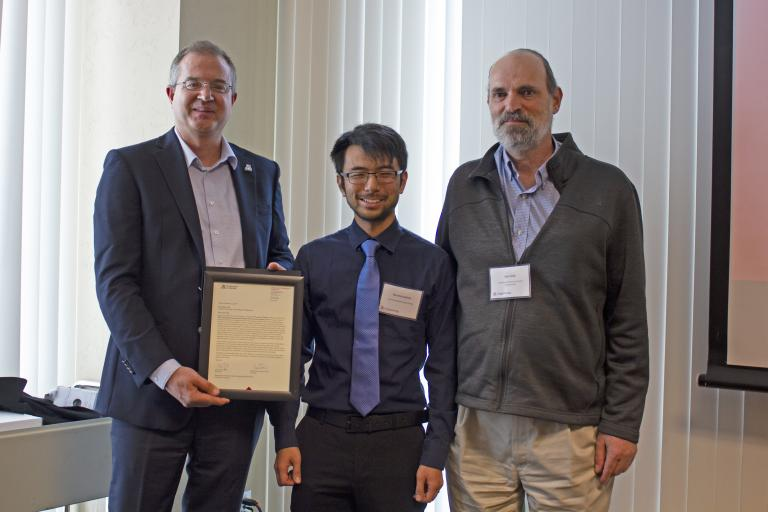 Warren Kadoya, outstanding graduate student in environmental engineering, with nominator Jim Field and Craig M. Berge Dean David Hahn.