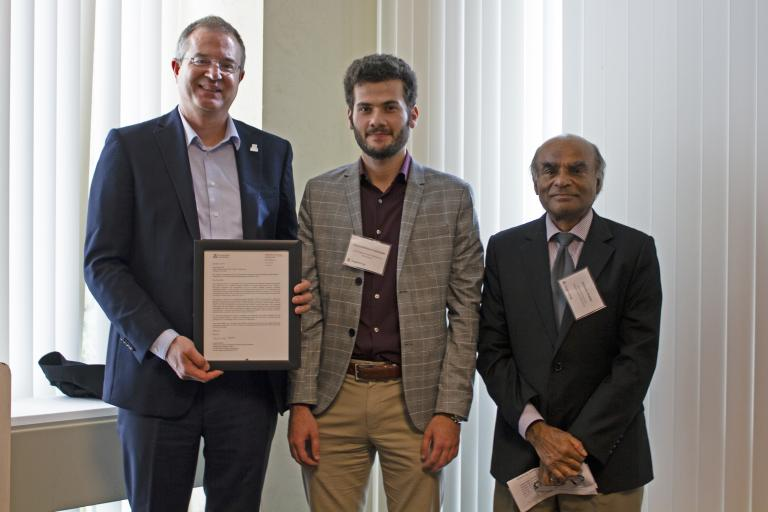Sayyed Mohsen Vazirizade, outstanding graduate student in civil engineering and engineering management, with nominator Achintya Haldar and Craig M. Berge Dean David Hahn.