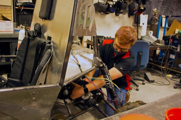 Erik Knowles working on the Baja SAE vehicle
