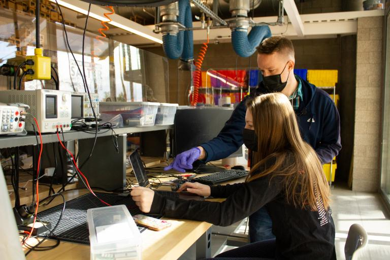 BME student Natalie Hall and TA Charles Perkins at work in the Salter Lab
