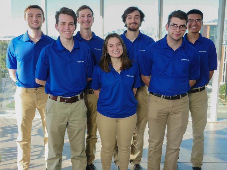Gregory Snyder, outstanding senior in mechanical engineering, with his senior design team.