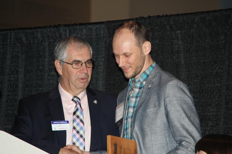 Young Professional Achievement Award recipient Ryan Kanto, right, with Dean Jeff Goldberg