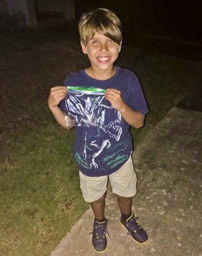 Puerto Rican child wirh water purifier