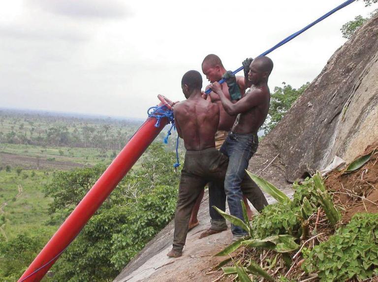 workers installing pipeline