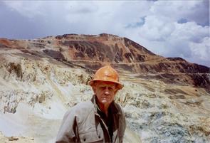 J. David Lowell wearing a hard hat at a mine.