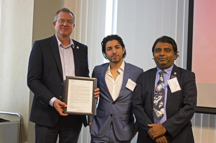 Jesse Samitas-Chavarria, outstanding senior in aerospace engineering, with nominator Jekan Thanga and Craig M. Berge Dean David Hahn.