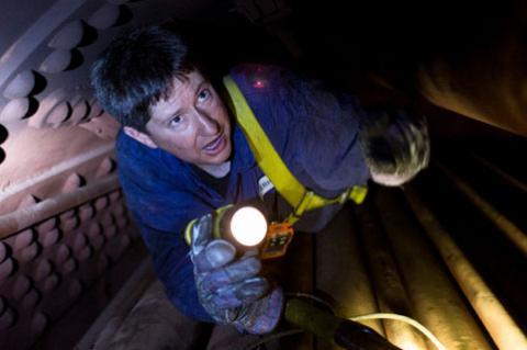 Eric Hadder inspects a boiler