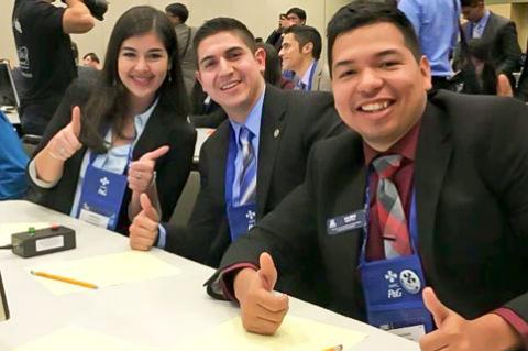 UA SHPE members Maria Lissette Flores, Fermin Prieto and Jaime Goytia celebrate winning the Academic Olympiad.