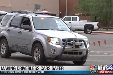 "Screencap of a newscast with a car driving across the frame and a lower-third caption that reads, ""Making Driverless Cars Safer: Students Show Off Technology at UA"""