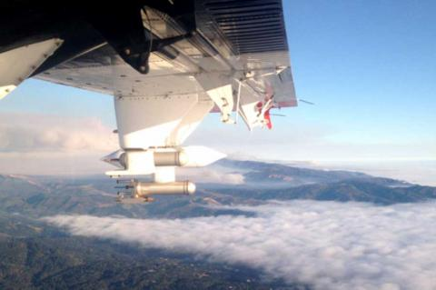 Photo taken from inside an airplane flying above the cloud layer.