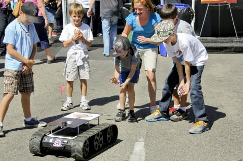 children playing with robot