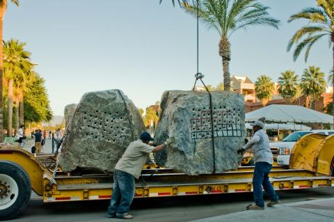 Crane Lifting Rocks