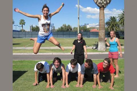 students doing acrobatics