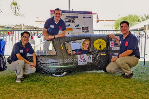 Engineering seniors with their human-powered vehicle