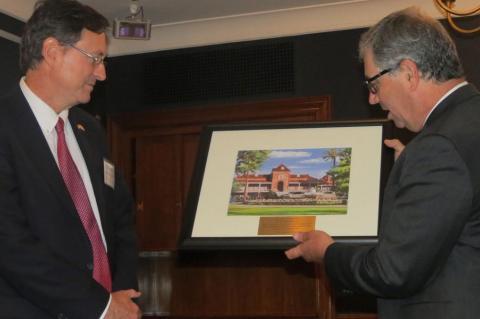 Jeff Goldberg hands plaque to Roman Macaya