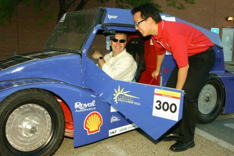 dean and student with solar car
