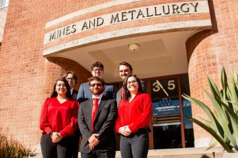 Five students stand on the front steps of the Mines and Metallurgy building.