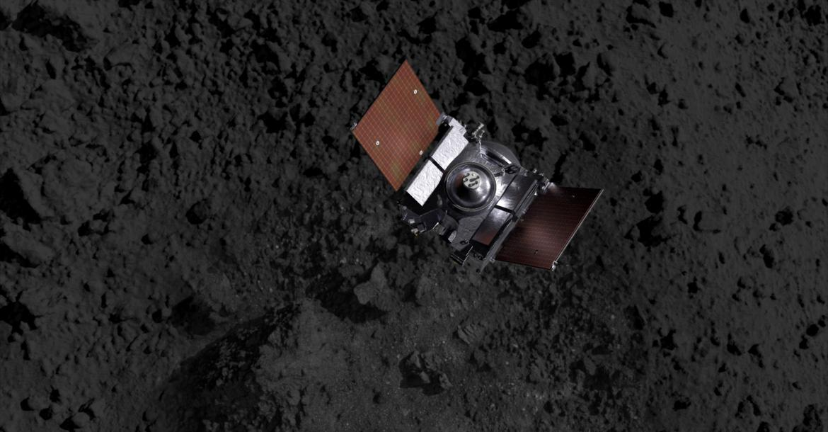 A spacecraft above an asteroid's terrain (artist's impression).