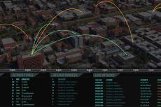 "A darkly tinted photo of an aerial view of a city, with lines connecting different buildings. Text along the bottom reads ""Attack Origins, Attack Types, Attack Targets and Live Attacks"""