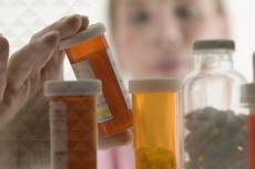 a pharmacist examines medications