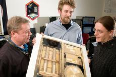 engineers examine test equipment