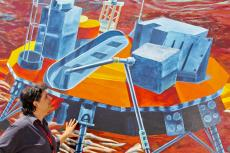 professor studies space mural