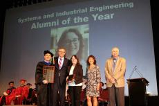 Young-Jun Son, Ted Landis, Marla Peterson, Ted Landis, Cindy Klingberg and Herb Burton on stage at SIE convocation ceremony