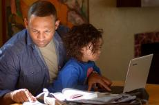 parent and child studying at home